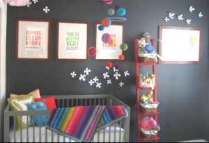 Neutral baby nursery with dark charcoal gray wall paint