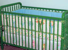 Used secondhand Jenny Lind baby crib painted John Deere tractor green using a DIY painting technique