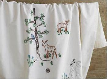 Coyuchi Thor Forest Friends Organic Baby Crib Collection with Embroidered Baby Deer and Woodland Creatures