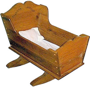 Homemade antique style wooden baby cradle