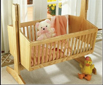 Heirloom style wooden pendulum rocking baby cradle