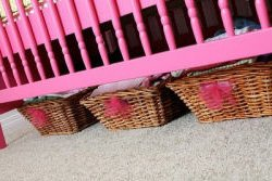 Baby crib painted hot pink using spray paint in a baby girl pink and green nursery room