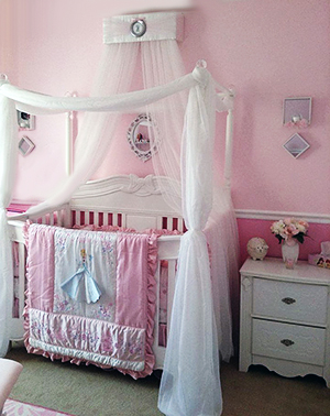 Pink Disney Princess baby nursery design with a baby bed canopy from SoZoeyBoutique and a homemade DIY crib canopy.