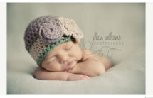 Purple, forest green and cream newborn baby girl chunky yarn baby beanie hat with large crochet flower pattern photo prop studio portrait