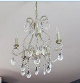 White crystal chandelier for a baby girl nursery room with tall ceilings