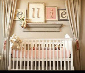 Baby girl nursery room with custom crib canopy drapes in pink and brown