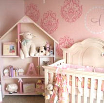 Elegant pink and ivory baby girl nursery with large damask stencil patterns on the wall