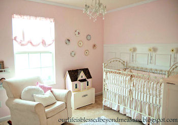 Ava's Rosy Pink and Khaki Nursery with a dollhouse and other vintage finds is a dream come true for a baby girl.