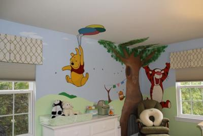 A complete view of our mural painting in our baby's Winnie the Pooh nursery