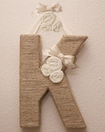 DIY craft project baby nursery wall letter initial monogram fabric flowers bow rope ribbon