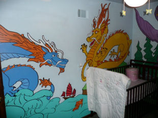 Painting of Chinese purple, red and green dragons on a dragon theme baby nursery wall mural art