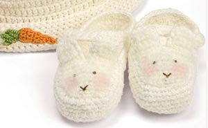 Crochet Easter bunny baby booties with hat and crocheted carrot