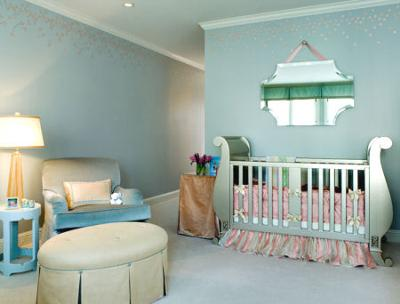 Elegant blush pink and blue baby nursery with metallic silver crib.