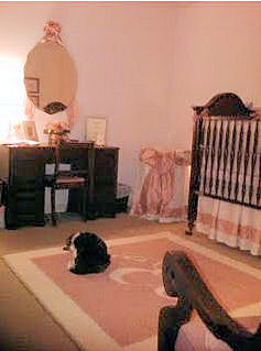 Pink And Brown Baby Girl Nursery with a vintage wall mirror, pink and white crib set and personalize nursery area rug with a large monogram initial and border