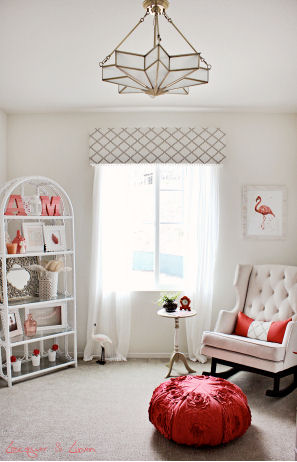 A modern nursery color scheme of taupe and cream with pops of bright coral