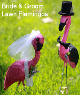 Lawn flamingos decorated as a bride and groom