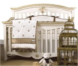 Antique gold metallic and ivory fleur de lis baby crib bedding set for a boy or girl nursery room