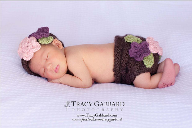 Baby diaper cover knitting pattern with hat decorated with flowers.  Knit diaper cover and hat headband decorated with crocheted floral decorations.