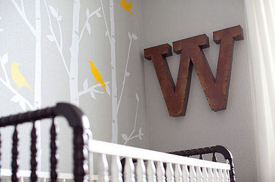 The iron wall letter adds a masculine personalized touch to the woodland themed nursery
