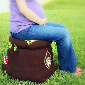 DIY homemade tree stump storage ottoman with felted mushrooms to make using felting arts and crafts nursery project