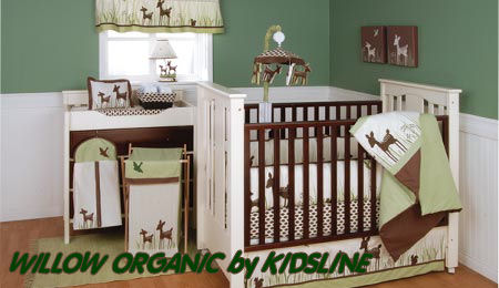 Forest friends deer baby crib bedding set in a green and brown woodland themed baby nursery room