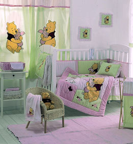 Pink Winnie the Pooh nursery ideas for a baby girl with crib bedding and appliqued curtains