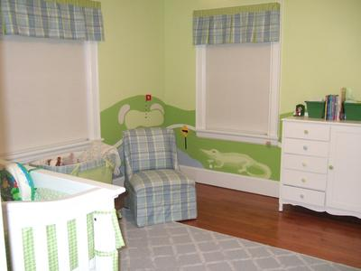 Our Baby Boy's Golf Theme Nursery.  The color scheme is baby blue and leaf green.  The baby bedding set is made using blue and green houndstooth fabric fabric that coordinates beautifully with the plaid fabric that I used for the window valances and chair upholstery.