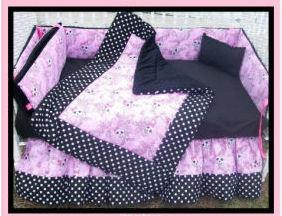 Pink gothic skull baby crib bedding set for a goth girl nursery theme