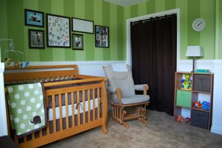 Green and brown elephant nursery with striped walls