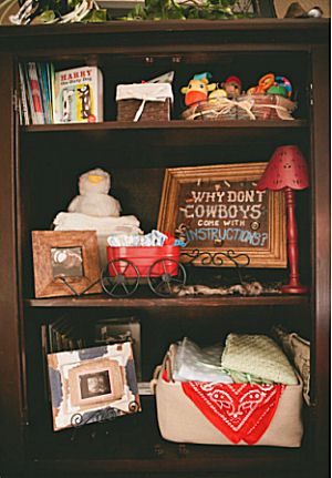 Western baby boy cowboy theme nursery decorations on shelves