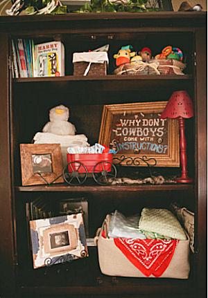 Western baby boy cowboy theme nursery decorations on shelves