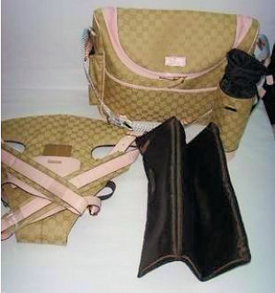 Authentic designer Gucci baby diaper changing bag bottle holder and baby carrier in pink for baby girls