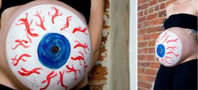 Halloween Pregnancy Belly Painting Ideas.  A pregnant belly painted like an eyeball.