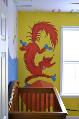 The Fox in Socks portion of the Dr. Seuss nursery wall mural near the baby's crib.