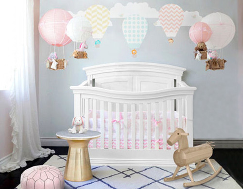 Hot air balloon baby nursery decorating ideas with decals and DIY hot air balloon crib mobiles in a baby girl nursery room