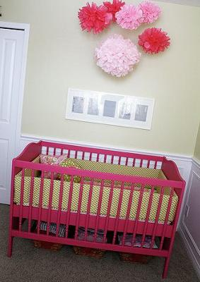 Recycled vintage Jenny Lind baby crib painted hot pink for a pink and green baby girl nursery room.