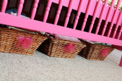 Woven baby girl nursery storage baskets decorated with homemade hot pink tulle puffs
