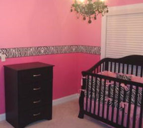 Baby girl hot pink and zebra print nursery bedding with black crib and wallpaper border