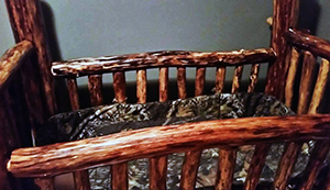 Rustic natural baby crib made by dad with a camo crib bedding set