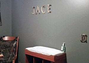 The letters that spell baby's name on the nursery wall are made with deer horns