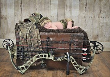 Rustic baby boy bow hunting theme newborn portrait