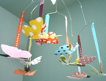 Modern butterfly baby ceiling mobile in a baby girl nursery room