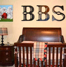 Baby boy sports theme nursery with football decorations and a Burberry plaid crib bedding set