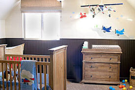 Colorful airplane nursery theme decorated for a baby boy with a mix of modern and vintage planes