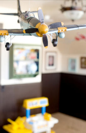 Jet airplane theme ceiling mobile in a baby boy nursery room