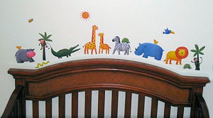 Jungle safari animals and zoo animals with letter decals spelling the baby' name on the nursery wall