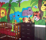Colorful jungle baby nursery room with elephants lions tigers hippos and a giraffe in the wall mural