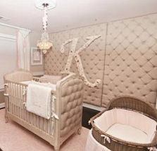 Pink baby girl princess nursery with tufted walls