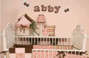 Pink and brown baby girl ladybug baby nursery crib bedding wooden wall letters and decor with vintage white iron bed