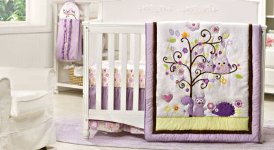 Purple and lavender forest theme nursery with baby crib bedding set with owls squirrels and hedgehogs